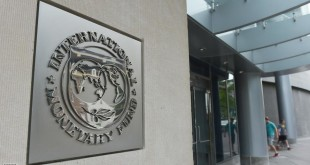 The seal of the International Monetary Fund is seen on a headquarters building in Washington, DC on July 5, 2015. The euro was dropping against the dollar after early results of the Greece bailout referendum suggested the country rejected fresh austerity demands from EU-IMF creditors. AFP PHOTO/MANDEL NGAN        (Photo credit should read MANDEL NGAN/AFP/Getty Images)