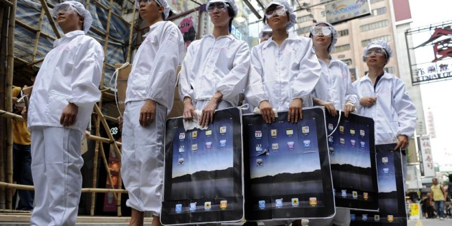 "Participants dressed up to represent Foxconn workers take part in a protest against Taiwanese technology giant Foxconn, which manufactures Apple products in mainland China, outside an Apple retail outlet in Hong Kong on May 7, 2011.  Taiwanese technology giant Foxconn treats its workers like ""machines"" a Hong Kong based labour group said on May 3, after a survey based on interviews with the firm's workers in mainland China. At least 13 Foxconn employees died in apparent suicides last year, which rights activists blamed on tough working conditions in a case that highlighted the challenges faced by millions of Chinese factory workers.   AFP PHOTO / Antony DICKSON (Photo credit should read ANTONY DICKSON/AFP/Getty Images)"