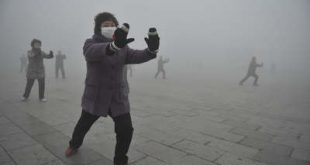 Retirees play Taichi during their morning exercise on a hazy day in Fuyang city, in central China's Anhui province, Monday Jan. 14, 2013. Air pollution is a major problem in China due to the country's rapid pace of industrialization, reliance on coal power, explosive growth in car ownership and disregard for environmental laws. (AP Photo)  CHINA OUT ORG XMIT: XAY802