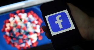 Facebook logo is displayed on a mobile phone screen photographed on coronavirus COVID-19 illustration graphic background on March 25, 2020 in Arlington, Virginia. (Photo by Olivier DOULIERY / AFP)