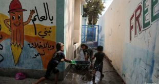 Palestinian children, who fled their homes due to Israeli air and artillery strikes, play with water at a United Nations-run school where they take refuge, in Gaza City May 18, 2021. REUTERS/Suhaib Salem