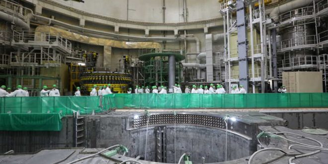 """This handout picture taken on August 7, 2020 and provided by the Russian state nuclear agency Rosatom shows employees fuelling up the first of two reactors of the Ostrovets nuclear power plant during the plant's physical launch. - The energy ministry said that power generation will begin in autumn and the station will ultimately supply a third of the country's energy needs. (Photo by Handout / Russia's state nuclear agency Rosatom / AFP) / RESTRICTED TO EDITORIAL USE - MANDATORY CREDIT """"AFP PHOTO / Russia's state nuclear agency Rosatom / HO """" - NO MARKETING - NO ADVERTISING CAMPAIGNS - DISTRIBUTED AS A SERVICE TO CLIENTS"""