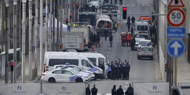 Belgian police and emergency personnel secure the Rue de la Loi following an explosion in Maalbeek metro station in Brussels  Belgium  March 22  2016    REUTERS Vincent Kessler
