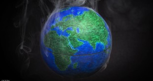 A picture taken on November 10, 2015 shows a small globe surrounded by smoke to illustrate global warming. France will be hosting and presiding the 21st Session of the Conference of the Parties to the United Nations Framework Convention on Climate Change (COP21/CMP11), also known as Paris 2015 from November 30 to December 11. AFP PHOTO / LIONEL BONAVENTURE        (Photo credit should read LIONEL BONAVENTURE/AFP/Getty Images)
