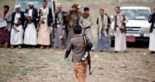 An armed boy walks as he attends a gathering held by tribesmen loyal to the Houthi movement to show support to a political council formed by the movement and the General People's Congress party to unilaterally rule Yemen by both groups in Sanaa, August 14, 2016. REUTERS/Khaled Abdullah