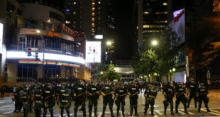 Police hold their lines in uptown Charlotte, NC during a protest of the police shooting of Keith Scott, in Charlotte, North Carolina, U.S. September 21, 2016. REUTERS/Jason Miczek     TPX IMAGES OF THE DAY