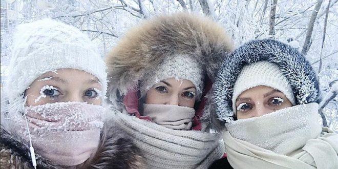 In this photo taken on Sunday  Jan  14  2018  Anastasia Gruzdeva  left  poses for selfie with her friends as the temperature dropped to about -50 degrees  -58 degrees Fahrenheit  in Yakutsk  Russia  Temperatures in the remote  diamond-rich Russian region of Yakutia have dropped to near-record lows  plunging to -67 degrees Centigrade  -88 6 degrees Fahrenheit  in some areas   sakhalife ru photo via AP