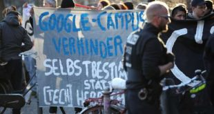 """BERLIN, GERMANY - APRIL 06: Protesters make noise and hold a banner that reads: """"Stop the Google Campus, Self-determination Instead of Domination"""" outside the Umspannwerk building where U.S. tech company Google is to open a Google Campus for startups on April 6, 2018 in Berlin, Germany. Approximately 100 demonstrators beat pots and pans and blew into horns. The project, in traditionally left-leaning Kreuzberg district, has provoked the ire of many local residents, who fear the Google Campus will accelerate gentrification in the area. (Photo by Sean Gallup/Getty Images)"""