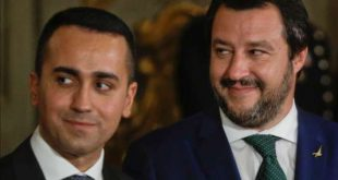 FILE - In this June 1, 2018 file photo, leader of the League party Matteo Salvini, right, stands by Luigi Di Maio, leader of the Five-Star movement, prior to the swearing-in ceremony for Italy's new government at Rome's Quirinale Presidential Palace. Five weeks after taking national office, opinion polls indicate that Salvini's anti-migrant, anti-European Union party has soared in popularity.(AP Photo/Gregorio Borgia, file)