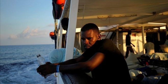 A migrant sits on board NGO Proactiva Open Arms rescue boat in central Mediterranean Sea  August 6  2018  REUTERS Juan Medina