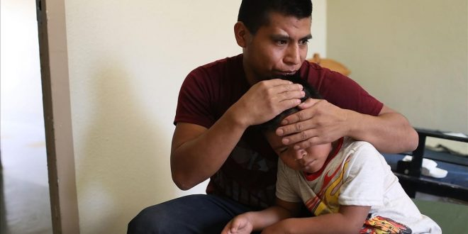 EL PASO  TX - JULY 19  A man  identified only as Antonio   hugs his son  Vauldio  7  in an Annunciation House facility after they were reunited yesterday on July 19  2018 in El Paso  Texas  The two  orginally from Guatemala  were reunited in an I C E processing center after being separated for two and one half months when they tried to cross into the United States  A court-ordered July 26th deadline is approaching for the U S  government to reunite as many as 2 551 migrant children ages 5 to 17 that had been separated from their families    Joe Raedle Getty Images AFP    FOR NEWSPAPERS  INTERNET  TELCOS   TELEVISION USE ONLY