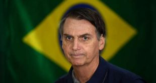 (FILES) In this file photo taken on October 07, 2018 Brazil's right-wing presidential candidate for the Social Liberal Party (PSL) Jair Bolsonaro walks in front of the Brazilian flag as he prepares to cast his vote during the general elections, in Rio de Janeiro, Brazil. Bolsonaro plans to redefine Brazil's diplomatic alliances. / AFP / Mauro PIMENTEL