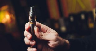 Close up of a man inhaling from an electronic cigarette