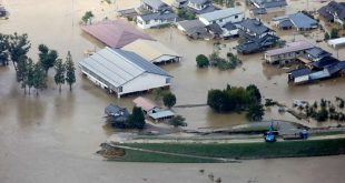"TOPSHOT - This aerial view shows flooded homes beside the collapsed bank of the Chikuma river in Nagano, Nagano prefecture on October 13, 2019, one day after Typhoon Hagibis swept through central and eastern Japan. - At least 15 people are dead and nine others missing, officials said on October 13, a day after powerful Typhoon Hagibis slammed into Japan, unleashing ""unprecedented"" rain and catastrophic flooding. (Photo by JIJI PRESS / JIJI PRESS / AFP) / Japan OUT TOPSHOT-JAPAN-WEATHER-TYPHOON"