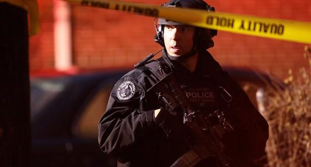 JERSEY CITY, NJ - DECEMBER 10: A police officer secures the scene of a shooting that left multiple people dead on December 10, 2019 in Jersey City, New Jersey. In a raging gun battle that by some accounts lasted in excess of an hour, six people - a Jersey City police officer, three civilians and two suspects - were killed in the Tuesday afternoon standoff and shootout across the Hudson River from Manhattan, according to published reports.   Rick Loomis/Getty Images/AFP