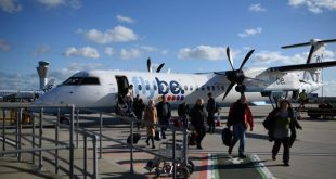 (FILES) In this file photo taken on November 8, 2017 passengers dissembark from a Flybe aircraft after landing at Jersey Airport in St Peter, north of St Helier, on the British island of Jersey. - British regional airline Flybe has collapsed with all its flights grounded, the company said on March 5, 2020, as the coronavirus epidemic takes a heavy toll on airlines around the world. (Photo by Oli SCARFF / AFP)
