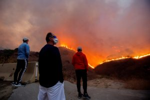 Residents watch the Blue Ridge Fire burning in Yorba Linda, California, U.S., October 26, 2020. REUTERS/Ringo Chiu