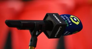 A microphone of the French tv channel Canal + is pictured during the French L1 football match between Paris Saint-Germain and Nimes Olympique at the Parc des Princes stadium in Paris on February 3, 2020. (Photo by FRANCK FIFE / AFP)