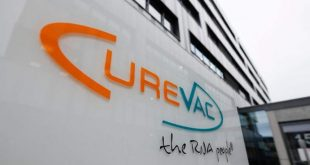 """(FILES) In this file photo taken on December 15, 2020 the logo of the biopharmaceutical company CureVac, is displayed in front of the company's headquarters in Tuebingen, southern Germany. - A Covid-19 vaccine being developed by Germany's CureVac was shown to be just 47 percent effective in an interim analysis of its late-stage trial, the company said on June 16, 2021. """"CVnCoV demonstrated an interim vaccine efficacy of 47 percent against Covid-19 disease of any severity and did not meet prespecified statistical success criteria,"""" CureVac said in a statement. (Photo by THOMAS KIENZLE / AFP)"""