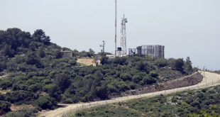 A general view taken from the Lebanese side of the border with Israel shows an Israeli observation station near the Israeli kibbutz of Hanita on April 20, 2017. Lebanon's Shiite Hezbollah movement, which fought a devastating war with the Jewish state in 2006, brought dozens of journalists to the demarcation line between Lebanon and Israel, to show that Israel is building up defences in anticipation of another conflict. / AFP PHOTO / JOSEPH EID