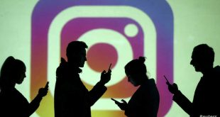 FILE PHOTO: Silhouettes of mobile users are seen next to a screen projection of Instagram logo in this picture illustration taken March 28, 2018.  REUTERS/Dado Ruvic/Illustration/File Photo