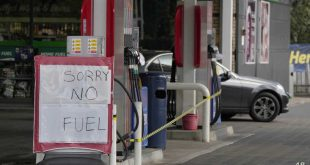 A sign reading Sorry No Fuel is displayed at a petrol station in London, Monday, Oct. 4, 2021. British military personnel have begun delivering fuel to gas stations after a shortage of truck drivers disrupted supplies for more than a week, leading to long lines at the pumps as anxious drivers scrambled to fill their tanks. (AP Photo/Frank Augstein)