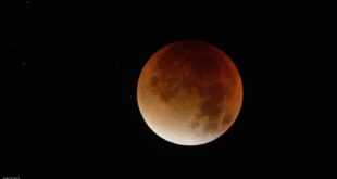 "A swollen ""supermoon"" bathed in the blood-red light of a total eclipse is seen in Nantes, western France, early on September 28, 2015. Skygazers were treated to a rare astronomical event when a swollen ""supermoon"" and lunar eclipse combined for the first time in decades, showing the planet bathed in blood-red light. AFP PHOTO / JEAN-SEBASTIEN EVRARD        (Photo credit should read JEAN-SEBASTIEN EVRARD/AFP/Getty Images)"