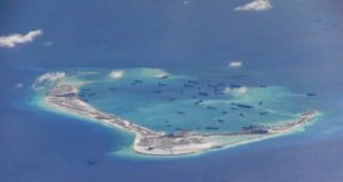 FILE PHOTO -  Chinese dredging vessels are purportedly seen in the waters around Mischief Reef in the disputed Spratly Islands in the South China Sea in this still image from video taken by a P-8A Poseidon surveillance aircraft provided by the United States Navy May 21  2015   U S  Navy Handout via Reuters File Photo  ATTENTION EDITORS - THIS PICTURE WAS PROVIDED BY A THIRD PARTY  REUTERS IS UNABLE TO INDEPENDENTLY VERIFY THE AUTHENTICITY  CONTENT  LOCATION OR DATE OF THIS IMAGE  THIS PICTURE IS DISTRIBUTED EXACTLY AS RECEIVED BY REUTERS  AS A SERVICE TO CLIENTS  EDITORIAL USE ONLY  NOT FOR SALE FOR MARKETING OR ADVERTISING CAMPAIGNS       TPX IMAGES OF THE DAY