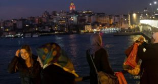 ISTANBUL  TURKEY - FEBRUARY 23  Women take photographs from the Galata bridge on February 23  2017 in Istanbul  Turkey  Turkey will hold its constitutional referendum on April 16  2017  Turks will vote on 18 proposed amendments to the Constitution of Turkey  The controversial changes seek to replace the parliamentary system and move to a presidential system which would give President Recep Tayyip Erdogan executive authority  Campaigning will officially begin on February 25 with a pro referendum rally to be held in Ankara and attended by Prime Minister Binali Yildirim    Photo by Chris McGrath Getty Images