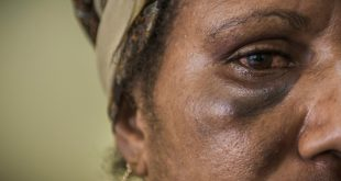 Cathy Wisil, 34, consulting at the family support centre in Port Moresby following inter-partner violence