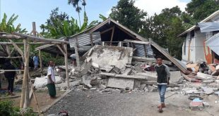 Villagers walk near destroyed homes in an area affected by the early morning earthquake at Sajang village  Sembalun  East Lombok  Indonesia  Sunday  July 29  2018  A shallow  magnitude 6 4 earthquake early Sunday killed at least 10 people and injured 40 on Indonesia s Lombok Island  a popular tourist destination next to Bali  officials said   AP Photo  Rosidin