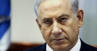 Israeli Prime Minister Benjamin Netanyahu looks on as he chairs the weekly cabinet meeting on July 6, 2014 at his Jerusalem office. Violence which rocked east Jerusalem for three days following the kidnap and murder on July 2 of a Palestinian teenager, spread to half a dozen Arab towns in Israel.   AFP PHOTO / POOL /GALI TIBBON