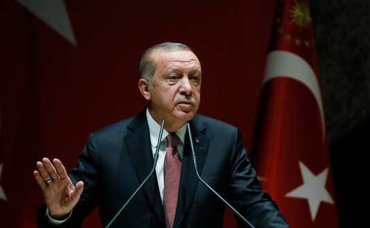 Turkey's President Recep Tayyip Erdogan talks to members of his ruling Justice and Development Party (AKP), in Ankara, Turkey, Friday, Oct. 26, 2018. The Saudi officials who killed journalist Jamal Khashoggi in their Istanbul consulate must reveal the location of his body, Erdogan said Friday in remarks that were sharply critical of the kingdom's handling of the case. (Presidential Press Service via AP, Pool)
