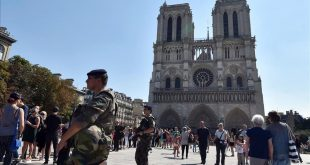 FILES  This file photo taken on August 15  2016 shows French soldiers patrolling in front of Notre Dame cathedral in Paris as part of the Sentinelle military force security mission while people queue for the mass for the feast of the Assumption on August 15  2016  French anti-terror police were holding two suspects on September 7  2016 after finding several gas cylinders in a car near Paris s Notre Dame cathedral  sources close to the investigation said  No detonators were found in the vehicle  which was discovered abandoned at the weekend  September 3 and 4  2016   the sources said  The car s owner and an associate  both known to police  were arrested on September 6  2016 they said  adding a preliminary investigation had been launched    AFP PHOTO   ALAIN JOCARD
