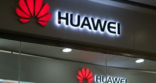 A Huawei logo is displayed at a retail store in Beijing on May 23, 2019. - Chinese telecom giant Huawei says it could roll out its own operating system for smartphones and laptops in China by the autumn after the United States blacklisted the company, a report said on May 23. (Photo by FRED DUFOUR / AFP)