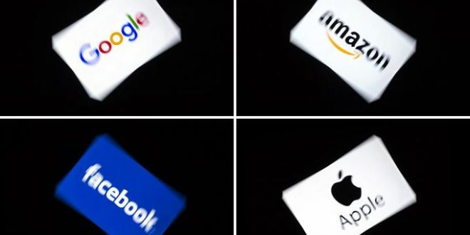 (COMBO) This combination of pictures shows the logos of the GAFA's, named after US  multinational technology and Internet-related services company Google, US online retail giant Amazon, US social media Facebook and US multinational technology company Apple, displayed on a tablet in Paris, on February 18, 2019. (Photo by Lionel BONAVENTURE / AFP)