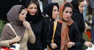 Iranian women walk in a street in Tehran 23 April 2007  The police bus screeches to a halt at a Tehran square packed with traffic  The officers leap out and begin spot checks on passing pedestrians and cars  Police work apparently like any other place in the world  But here in the Iranian capital their targets are women deemed to have infringed the Islamic republic s strict dress rules  AFP PHOTO ATTA KENARE
