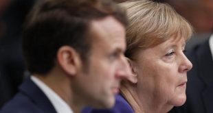 France's President Emmanuel Macron (L) and German Chancellor Angela Merkel (R) attend the plenary session of the NATO summit at the Grove hotel in Watford, northeast of London on December 4, 2019. (Photo by Adrian DENNIS / AFP)