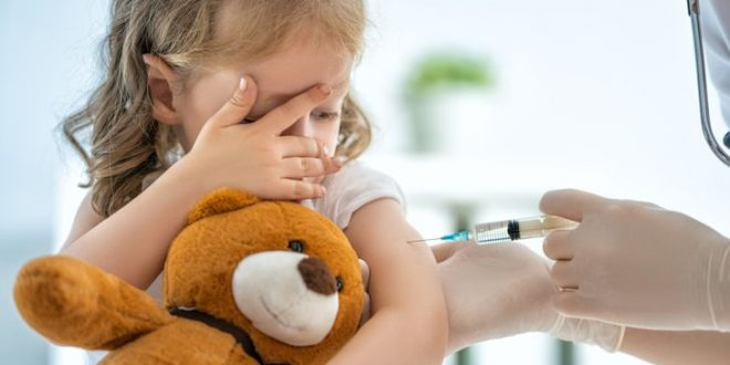 A doctor making a vaccination to a child